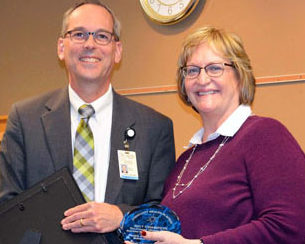 Prevention/Wellness Manager Vicky Ward recently received a Community Health in Action Award for substance-abuse prevention efforts by Tri-County Mental Health Services. Gary E. Zaborac, director of public health at the Clay County Public Health Center, presented the award.